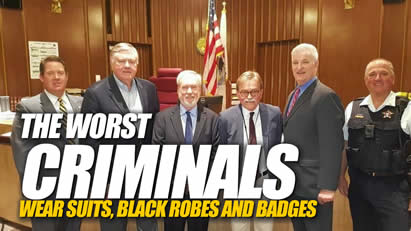 the worst criminals wear black robes suits and badges